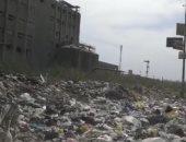 اضبط مخالفة.. تلال القمامة ومخلفات البناء تحاصر محطة قطار غزل المحلة.. صور