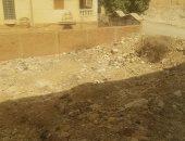 تراكم القمامة والحيوانات النافقة فى شارع الخزان بحدائق الأهرام