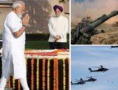 """صور.. العالم هذا الصباح.. تدريبات عسكرية تحاكى دخول جيش التحرير الشعبى الصيني لجزيرة بينجتونج.. رئيس الوزراء الهندى يضع باقات الورود على النصب التذكارى لـ""""المهاتما غاندى"""""""