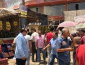 تحرير 196 مخالفة تعدٍ فى شارع عثمان محرم بالطالبية