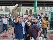 """""""السيلفى"""" أبرز مظاهر احتفال المواطنين بعيد الفطر فى أسيوط (صور)"""