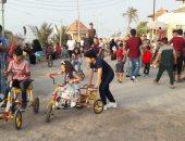 """""""الكورنيش والمراجيح"""".. فسحة أهالى شمال سيناء بشاطئ العريش فى العيد (صور)"""
