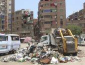 حملات نظافة ورفع الإشغالات بالدقى والعمرانية وأوسيم