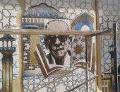 تركيب لوحات فنية أمام متحف نجيب محفوظ بالجمالية.. صور
