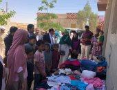 """صور.. """"القرية"""" مبادرة طلابية تبنتها جامعة بنى سويف لمساعدة الأسر الفقيرة"""