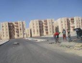 صور.. استمرار أعمال التطوير بامتداد طريق عمارات الإسكان الاجتماعى بالغردقة