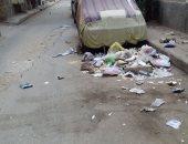 تراكم القمامة بشارع فؤاد الوسطانى بروض الفرج
