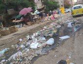 القمامة ومياه الصرف الصحى تحاصر سوق الخضار بشارع ترعة عبد العال بفيصل