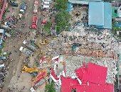 صور.. ارتفاع ضحايا انهيار مبنى فى كمبوديا إلى 13 قتيلا