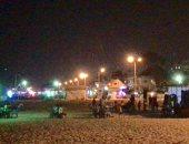 صور.. شاطئ العريش ملاذ الأسر ليلا وسهرات حتى منتصف الليل على الرمال الصافية