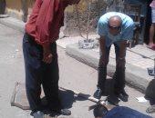 إصلاح هبوط أرضى وردم الحفر لتحقيق السيولة المرورية غرب الإسكندرية