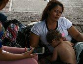 صور.. مجموعة من طالبى اللجوء بالمكسيك داخل مخيم مؤقت للهجرة