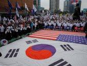 صور.. مسيرة فى كوريا الجنوبية تحتفى بزيارة ترامب إلى سول