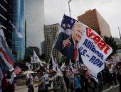 أعلام أمريكا وصور ترامب تزين كوريا الجنوبية قبل زيارته سول