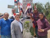 صور..اهالي كفر شكر بالقليوبية يحتفلون بذكرى ثورة 30 يونيو بالأعلام  والأغانى الوطنية