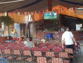 صور.. الأندية والمقاهى بأسيوط تستعد لمباراة مصر وأوغندا