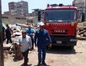 صور.. قوات الحماية المدنية بالغربية تسيطر على حريق فى خزان بوتامين بالمحلة