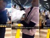 15قميص فوق بعض.. مسافر يحتال لعدم دفع الرسوم فى مطار فرنسى.. فيديو