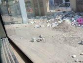 شكوى من تراكم القمامة والرديم على طول سور حدائق الأهرام