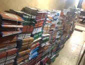 ضبط 37 ألف كتاب تعليمى وكراسات إجابة امتحانات داخل مكتبتين بالمطرية.. صور