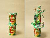 مابيرميش حاجة فى الزبالة.. فنان يحول علب الأطعمة الورقية إلى قطع فنية
