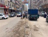 صور.. رفع 6 طن قمامة من محيط شارع مستشفى الصدر بالمنصورة