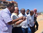 صور.. محافظ بورسعيد يتفقد العمل بكورنيش قناة الاتصال ومبنى المرور الجديدين