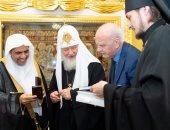 أمين عام رابطة العالم الإسلامى يلتقى بطريرك روسيا فى لقاء تاريخى