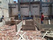 إيقاف بناء عقار مخالف وغلق محلين بدون ترخيص بالإسكندرية