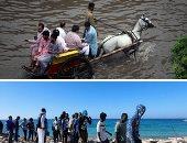 صور.. العالم هذا المساء.. إنقاذ عشرات المهاجرين غير الشرعيين قبالة السواحل الليبية.. مصرع 5 أشخاص جراء الفيضانات فى باكستان.. زعيم كوريا الشمالية يشاهد عملية إطلاق صاروخ باليستى جديد