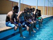 متحدو الإعاقة فى فلسطين بجلسة تدريب على السباحة