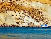 شاهد.. لحظة وصول مهاجرين غير شرعيين إلى سواحل إيطاليا