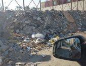 شكوى من تراكم مخلفات البناء بشارع عباد الرحمن بمساكن شيراتون