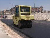صور.. بدء أعمال رصف طريق جمال عبد الناصر فى مدينة 6 أكتوبر