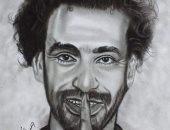 """""""أحمد إبراهيم"""" رسام يجيد رسم لاعبى كرة القدم.. صور"""