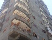 وقف البناء بمحل تجارى وعقار مخالف بحى الجمرك فى الإسكندرية
