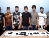 شرطة أبوظبى تضبط 3 عصابات آسيوية متخصصة فى النصب عن طريق الهواتف