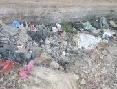 شكوى من تراكم القمامة فى شارع محمود عزب بمسطرد