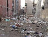 القمامة والمخلفات تزعج سكان شارع رئيسى بحدائق القبة