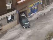 شاهد.. الفيضانات تجرف سيارات وتثير الفوضى فى العاصمة الإسبانية مدريد