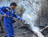 صور.. رئيس بوليفيا يشارك فى إخماد حرائق الغابات ببلاده