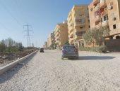 صور.. شكوى من عدم رصف شارع الخزان بحدائق الأهرام