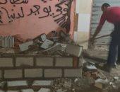إزالة سور مخالف فى حملة مسائية لحى ثان المنتزه بالإسكندرية