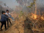 صور.. المواطنون فى بوليفيا يشاركون فى إخماد حرائق الغابات وينقذون الحيوانات