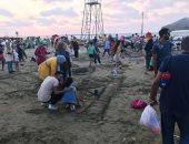 صور.. فعاليات مهرجان الرسم على الرمال بشواطئ مدينة رأس البر