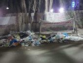 """أمام لافتة """"برجاء عدم إلقاء القمامة"""" تتراكم المخلفات فى شارع سعيد بمدينة طنطا"""