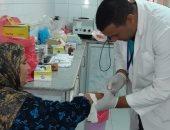 تقديم الكشف المجانى لـ 1449 مريضا بقرية أم دينار بالجيزة