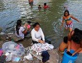 صور .. تزايد اعداد المهاجرين على الحدود الأمريكية المكسيكية