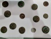 صور العملات الأثرية المضبوطة بمطاري الأقصر وأسيوط