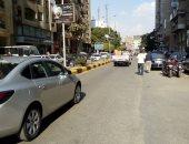 قارئ يشارك بصور لطلاء أرصفة شارع مصدق بالدقى وإزالة الأشغالات